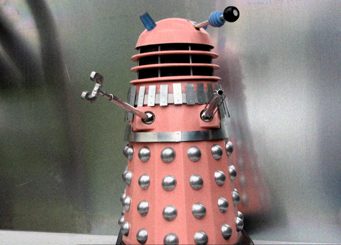 Pink Dalek looking away.
