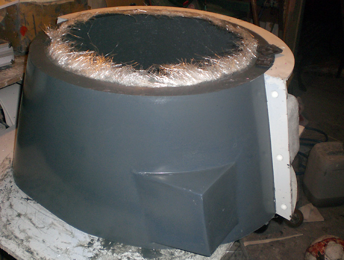 The fibreglass shoulders, partially de-moulded