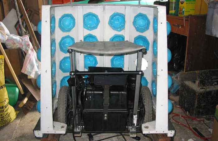 Inside the skirt, showing the electric wheelchair running gear.